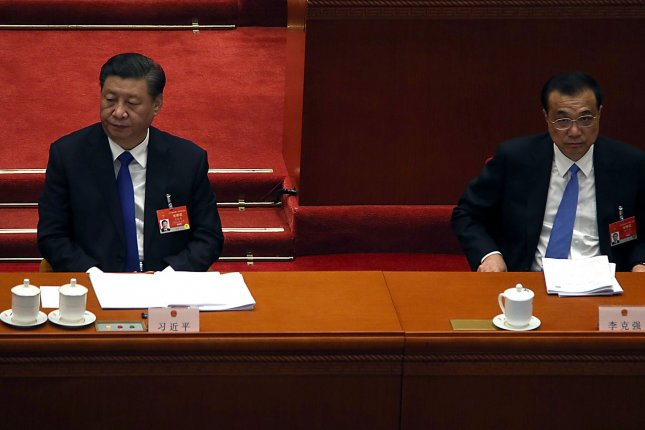 Chinese President Xi Jinping (L) and Premier Li Keqiang attend the Fourth Session of the 13th National People's Congress in the Great Hall of the People in Beijing. File Photo by Stephen Shaver/UPI