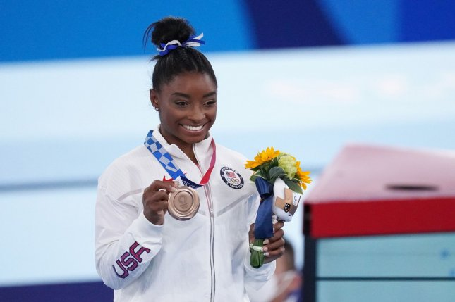 U.S. gymnast Simone Biles shows her bronze medal for the balance beam at the Ariake Gymnastics Centre at the 2020 Summer Olympic Games in Tokyo on August 3. On Wednesday, she will testify in the Senate in the Larry Nassar case. File Photo by Richard Ellis/UPI