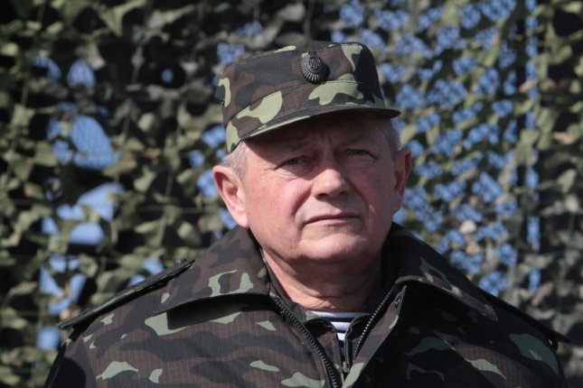 Ukrainian acting Defense Minister Ihor Teniuk attends a military exercise near Goncharovsk village of the Chernigov area in Ukraine on March 14, 2014. Teniuk discussed possible ways to ease tensions over Crimea with his Russian counterpart by phone Wednesday. UPI/Sergey Starostenko