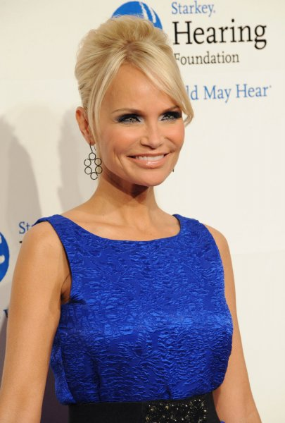 Actress Kristin Chenoweth arrives at the 2011 MusiCares Person of the Year tribute honoring Barbra Streisand in Los Angeles on February 11, 2011. UPI/Jim Ruymen