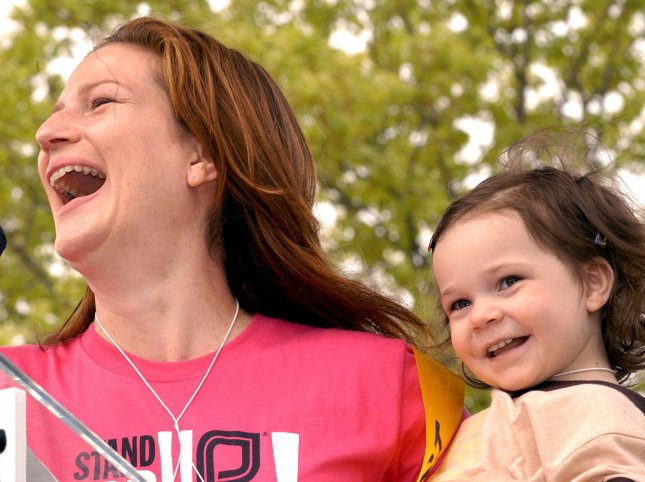 Actress Ana Gasteyer, accompanied by daughter Francis, speaks for abortion rights and in opposition to the Bush administration policies on family planning during the 'March For Women's Lives,' on the Mall in Washington, April 25, 2004. (UPI Photo/Rick Steele)