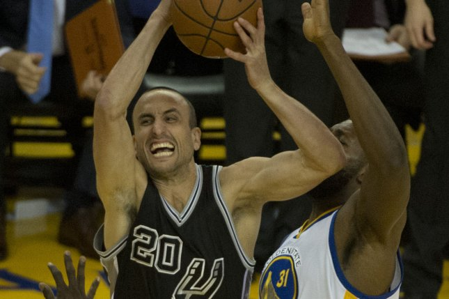 San Antonio Spurs' Manu Ginobili (20) puts up a shot against Golden State Warriors' Festus Ezeli in the first half at Oracle Arena in Oakland, California on April 7, 2016. The Warriors defeated the Spurs 112-101 to clinch top seed for the playoffs. Photo by Terry Schmitt/UPI