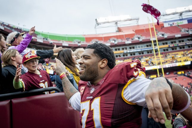 Washington Redskins' tackle Trent Williams celebrates as he walks to the locker room following the Redskins' 23-20 win over the Philadelphia Eagles at FedExField on October 4, 2015 in Landover, Maryland. Photo by Pete Marovich/UPI