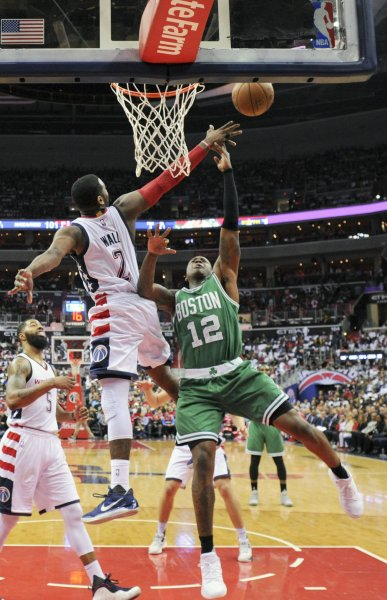 Boston Celtics guard Terry Rozier (12) is fouled by Washington Wizards guard John Wall (2) during their playoff game last season. Photo by Mark Goldman/UPI