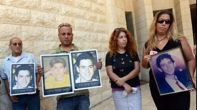 Bereaved Israelis hold photos of loved ones killed by Palestinians in terror attacks at a protest outside the Supreme Court in Jerusalem, Israel, against the upcoming Palestinian prisoner release, August 11, 2013. Israel is set to release 26 Palestinian prisoners with blood on their hands on Tuesday as a good will gesture to Palestinian President Mahmoud Abbas for restarting peace talks. Israeli and Palestinians negotiators are scheduled to meet on Wednesday, August 14 to resume peace talks. UPI/Debbie Hill
