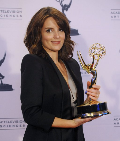 Actress Tina Fey appears backstage with her Emmy for Outstanding Guest Actress in a Comedy Series for her turn as former Alaska Gov. Sarah Palin on Saturday Night Live, at the Creative Arts Emmy Awards in Los Angeles, on September 12, 2009. UPI Jim Ruymen