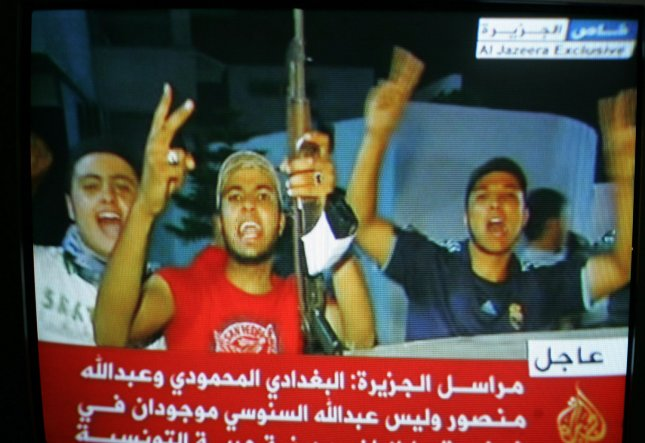 In an image taken from footage broadcast on Al-Jazeera television, Libyans celebrate the arrest of Gadhafi's son Saif al-islam and the partial fall of Tripoli in the hands of the Libyan rebels on August 21, 2011. Libyan rebels have reached the highly symbolic Green Square in the center of Tripoli on August 22, 2011. UPI