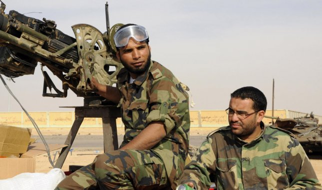 Libyan rebel fighter take a rest at a check point prior heading towards the front line outside the Libyan eastern city Ajdabiya on May 12, 2011, where fighting between rebels and forces loyal to leader Moamer Kadhafi is ongoing. Rebels controlled the airport in Misurata, spokesmen for the Libyan rebels said. UPI\Tarek Alhuony.