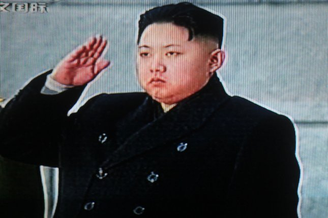 China's state television shows footage of Kim Jong Un saluting his father North Korean leader Kim Jong Il's body during a state funeral in Pyongyang December 28, 2011. (UPI/Stephen Shaver)