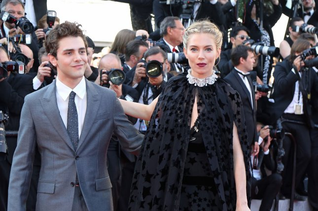 Jury members Xavier Dolan (L) and Sienna Miller arrive on the red carpet before the screening of the film Carol during the 68th annual Cannes International Film Festival in Cannes, France on May 17, 2015. Photo by David Silpa/UPI