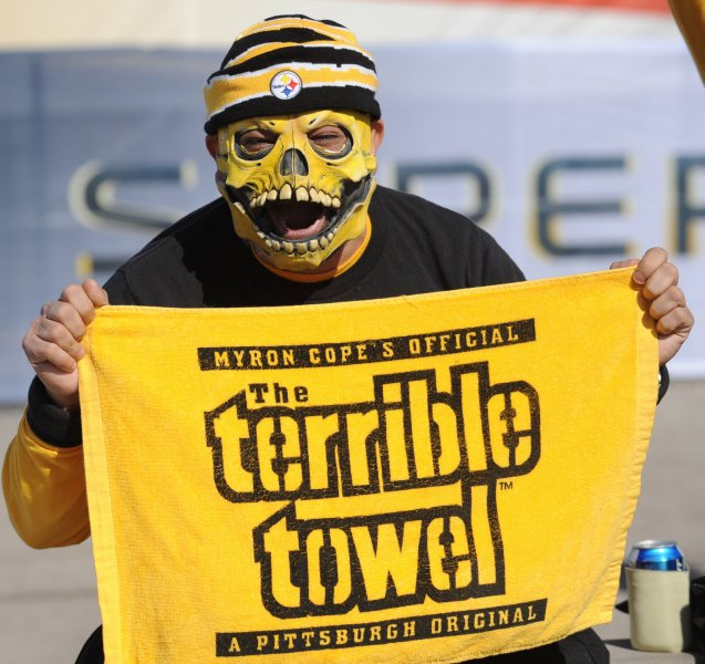 fa5d35c5fd3 A Pittsburgh Steelers fan holds his Terrible Towel. This season Steelers  fans are looking forward to seeing what veteran coach Mike Tomlin can do  with a ...