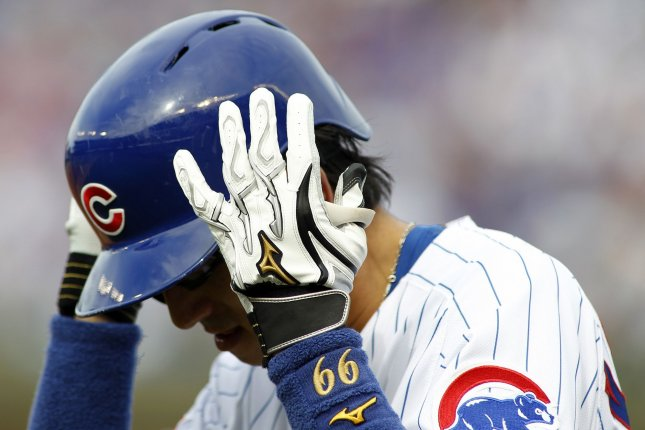 Chicago Cubs' Munenori Kawasaki adjusts his helmet as he goes back to the dugout after making an out against the Milwaukee Brewers in the third inning of their game on September 16, 2016 in Chicago. Photo by Frank Polich/UPI