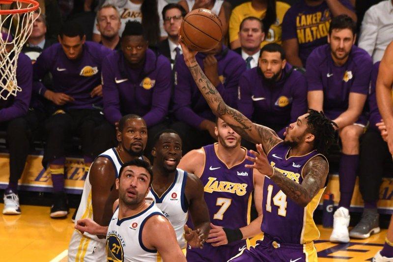 Lakers forward Brandon Ingram (14) shoots over Warriors Zaza Pachulia at Staples Center in Los Angeles, November 29, 2017. File photo by Jon SooHoo/UPI
