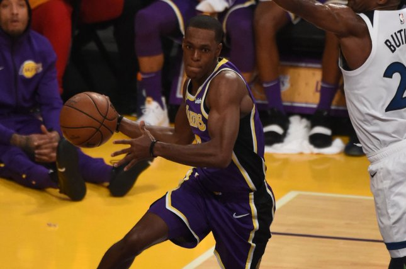 Los Angeles Lakers guard Rajon Rondo (9) passes the ball against the Minnesota Timberwolves at Staples Center in Los Angeles. Photo by Jon SooHoo/UPI