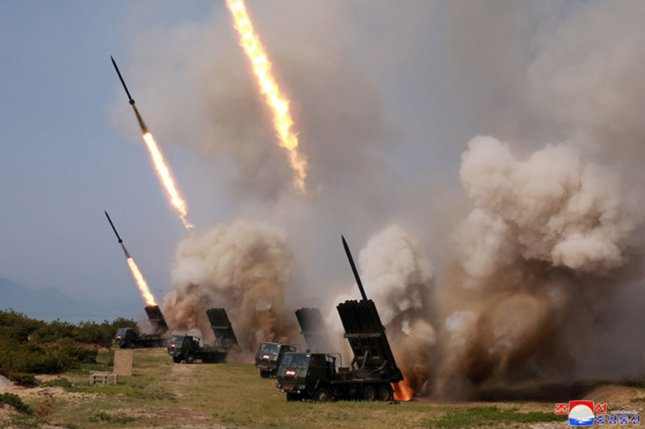This image released Sunday by KCNA shows rockets being launched in a strike drill supervised by North Korean leader Kim Jong Un. Photo by KCNA/UPI