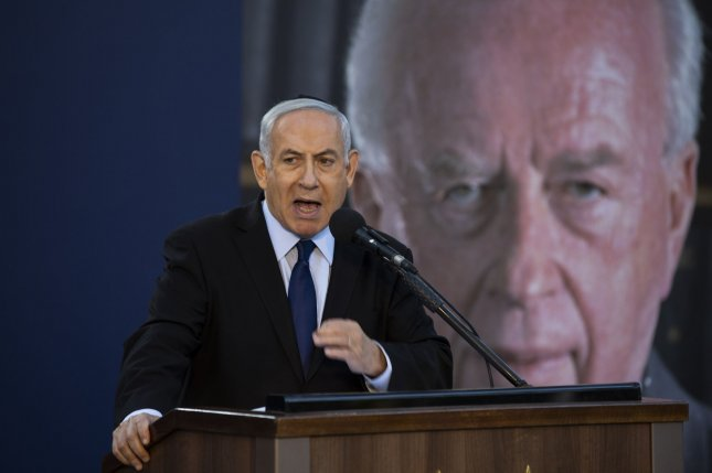Israeli Prime Minister Benjamin Netanyahu speaks as he attends a state memorial ceremony for Yitzhak and Leah Rabin, at Mt. Herzl in Jerusalem on Sunday. Photo by Heidi Levine/UPI