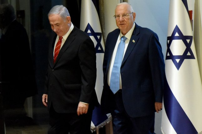 Israeli Prime Minister Benjamin Netanyahu (L) and President Reuven Rivlin arrive for a September 25 news conference after Netanyahu was given the first mandate to form a coalition government. File Photo by Debbie Hill/UPI