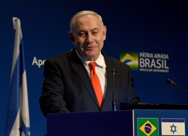 Israeli Prime Minister Benjamin Netanyahu speaks at a ceremony for the opening of the Brazil Trade Mission in Jerusalem, where Eduardo Bolsonaro, son of Brazilian president Jair Bolsonaro, said Brazil will move its embassy to Jerusalem. Photo by Debbie Hill/UPI