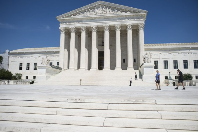 The Supreme Court Building stands against a bright blue sky on June 20, 2016, in Washington, D.C. The court said Tuesday it won't review a case related to the Flint, Mich., water crisis. Photo by Pete Marovich/UPI