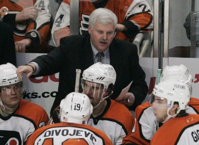 Philadelphia Flyers head coach Ken Hitchcock, center, talks to his team during a timeout against the Chicago Blackhawks during the third period in Chicago on January 11, 2006. The Flyers won 5-2. (UPI Photo/Brian Kersey)
