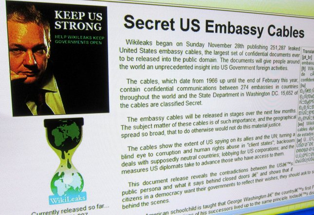 The WikiLeaks Internet page discussing the United States Embassy Cables and showing WikiLeaks founder Julian Assange is displayed on December 5, 2010. Supporters view Assange as a savior of free speech, whereas critics call him a 'terrorist' for releasing classified material from the United States government. UPI