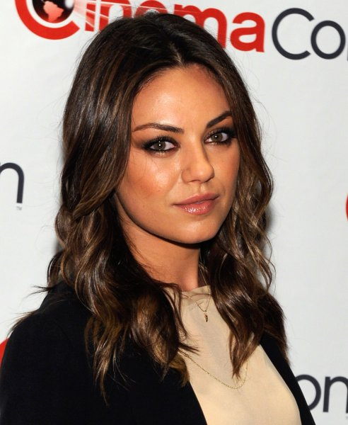 Actress Mila Kunis arrives at a Walt Disney Studios Motion Pictures event to promote her upcoming movie, 'Oz: The Great and Powerful' at Caesars Palace during CinemaCon, the official convention of the National Association of Theatre Owners, in Las Vegas, Nevada on April 24, 2012. UPI/David Becker