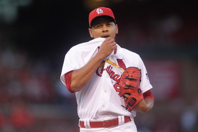 St. Louis Cardinals starting pitcher Carlos Martinez wipes his face at the end of the first inning against the Pittsburgh Pirates at Busch Stadium in St. Louis on August 11, 2015. Photo by Bill Greenblatt/UPI
