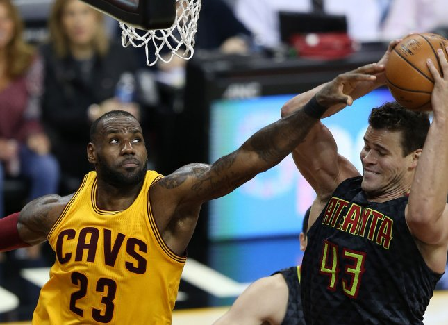 Cleveland Cavaliers' LeBron James battles Kris Humphries of the Atlanta Hawks for a rebound during the second half at Quicken Loans Arena in Cleveland on April 7, 2017. Photo by Aaron Josefczyk/UPI