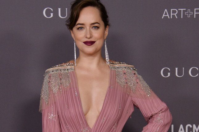 Actress Dakota Johnson attends the seventh annual LACMA Art+Film gala honoring artist Mark Bradford and filmmaker George Lucas in Los Angeles on November 4. She will be a presenter at the Golden Globe Awards ceremony. File Photo by Jim Ruymen/UPI