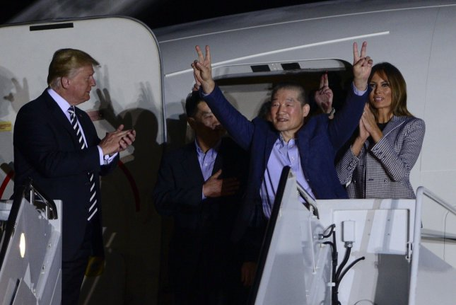 President Donald Trump and First Lady Melania Trump greet the three American citizens Kim Hak-Song, Kim Dong-Chul, and Kim Sang-Duk, who were detained in North Korea, at Joint Base Andrews, Maryland on Thursday. Photo by Leigh Vogel/UPI