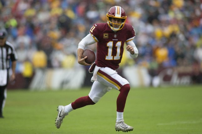 Washington Redskins quarterback Alex Smith (11) runs with the football during Week 3 of the NFL season against the Green Bay Packers on September 23, 2018 at FedEx Field in Landover, Maryland. Photo by Alex Edelman/UPI
