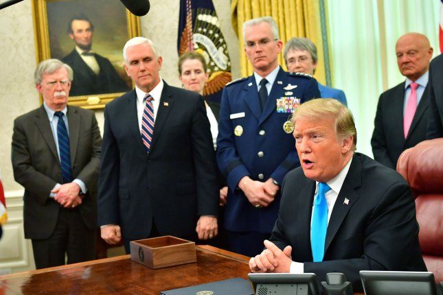 President Donald Trump speaks to the media after signing Space Policy Directive-4 in the Oval Office at the White House in Washington, D.C., on Tuesday. Photo by Kevin Dietsch/UPI