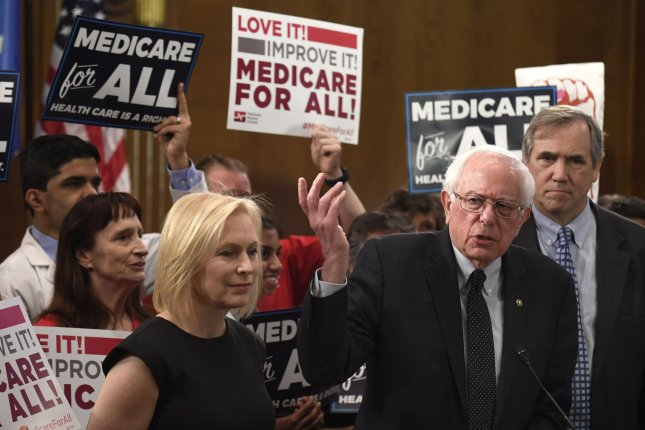Sen. Bernie Sanders, I-Vt., announces his Medicare for All Act of 2019 Wednesday at the U.S. Capitol. Sens. Kristen Gillibrand of New York (L) and Edward Markey of Massachusetts also attended. Photo by Mike Theiler/UPI