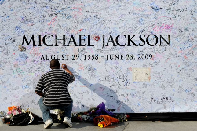 A fan signs a large poster at the Staples Center in Los Angeles on July 6, 2009. The venue was the planned location for late pop star Michael Jackson's memorial service scheduled for July 7, 2009. Photo by Jim Ruymen/UPI