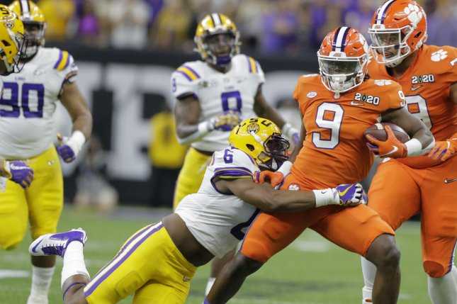 Clemson Tigers running back Travis Etienne (9) takes a pass up the field against the LSU Tigers during the first quarter of the College Football Playoff National Championship Game on Monday at the Superdome in New Orleans. Photo by AJ Sisco/UPI