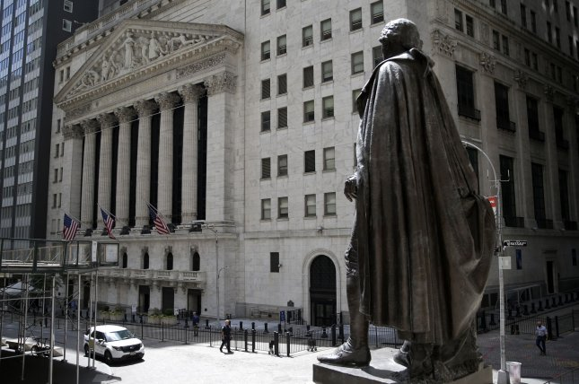 A statue of George Washington looks over the New York Stock Exchange in New York City last Friday, which remains partially closed due to the coronavirus pandemic. Photo by John Angelillo/UPI