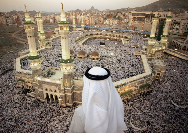 Ghassan, a Saudi officer, looks at Muslims pilgrims while they pray at the birthplace of prophet Mohammed at the Grand Mosque, Islam's holiest shrine in Mecca, Saudi Arabia on December 4, 2008. More than two million Muslims head to the holy city of Mecca, Saudi Arabia, to make the annual Hajj pilgrimage. All fit and financially able Muslims are expected to perform the Hajj at least once in their life. (UPI Photo/Mohammad Kheirkhah)