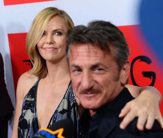 Cast member Sean Penn and his girlfriend, actress Charlize Theron attend the premiere of the motion picture crime thriller The Gunman at Regal Cinemas L.A. Live in Los Angeles on March 12, 2015. Photo by Jim Ruymen/UPI