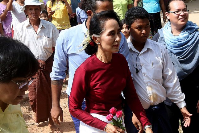 Myanmar pro-democracy leader Aung San Suu Kyi, center, takes control over energy portfolio in new civilian-led government. Asian Development Bank said energy investments may help spur economic development in the country known formerly as Burma. File photo by Hongsar Ramonya/ UPI
