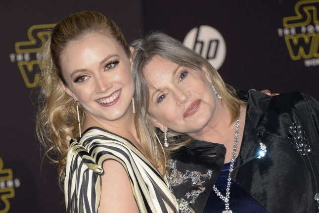 Billie Lourd (L) and Carrie Fisher attend the Los Angeles premiere of Star Wars: The Force Awakens on December 14, 2015. Lourd rang in her birthday with dad Bryan Lourd, Emma Roberts, Colton Haynes and other pals Sunday. File Photo by Phil McCarten/UPI