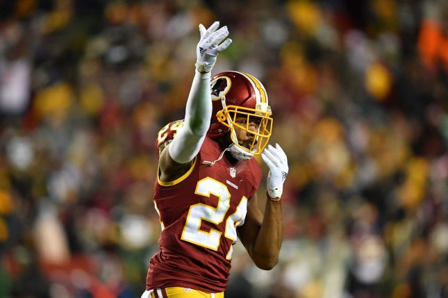 Washington Redskins cornerback Josh Norman celebrates during a game against the Green Bay Packers. Photo by Kevin Dietsch/UPI