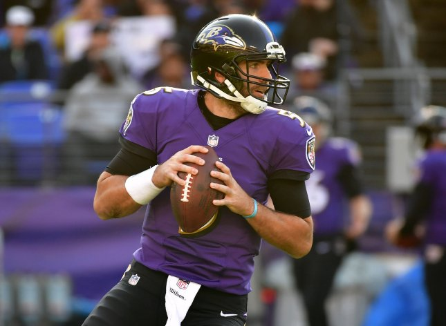 Baltimore Ravens quarterback Joe Flacco looks to pass during a game against the Detroit Lions in Maryland. Photo by Kevin Dietsch/UPI