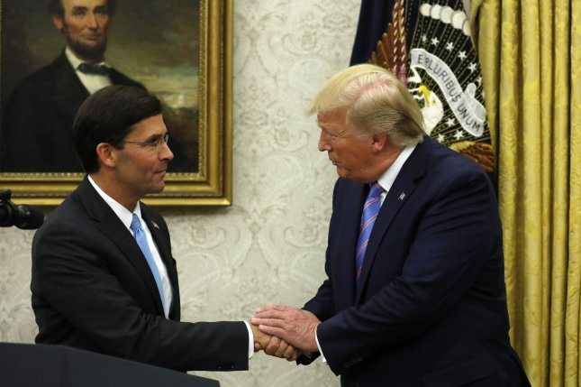 U.S. President Donald Trump congratulates Mark Esper after swearing him in as the new secretary of defense in the Oval Office of the White House in Washington on Tuesday. Photo by Yuri Gripas/UPI