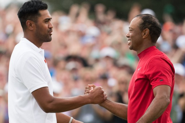 Tony Finau (L) had a first-round lead, while Tiger Woods (R) almost missed the third-round cut at the 2020 Memorial Tournament, which runs through Sunday in Dublin, Ohio. File Photo by Kevin Dietsch/UPI