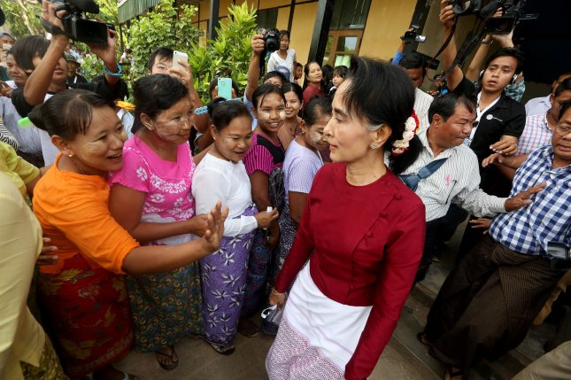 Detained Myanmar civilian leader Aung San Suu Kyi is shown with supporters in Kawhmu Township on November 8, 2015. Her trial started Monday with prosecution witnesses. File Photo by Hongsar Ramonya/ UPI