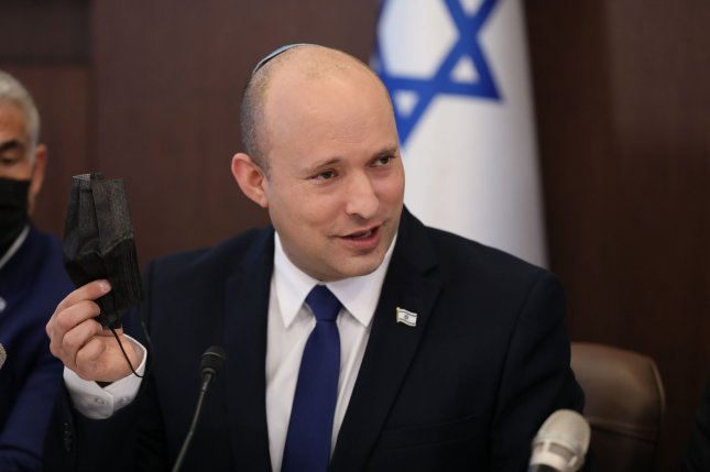 Israeli Prime Minister Naftali Bennett attends a meeting at his office in Jerusalem on Sunday. The Knesset failed to extend a controversial citizenship law he favored on Tuesday. Photo by Abir Sultan/UPI
