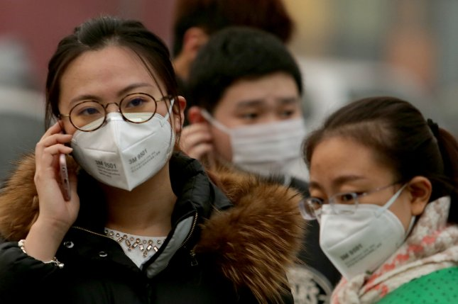 A study involving more than 66,000 older residents of Hong Kong found an increased risk of dying from cancer for even small increases in exposure to these tiny particles of air pollution. Pictured, Chinese people wear protective face masks to protect against the deadly pollution in Beijing. File photo by Stephen Shaver/UPI
