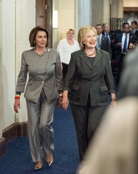 Democratic presidential candidate and former Secretary of State Hillary Clinton walks with House Minority Leader Nancy Pelosi as Clinton visits House Democrats on Wednesday at the U.S. Capitol. Photo by Ken Cedeno/UPI