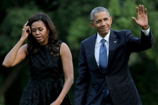 President Barack Obama and first lady Michelle Obama, pictured returning to the White House last week, are scheduled to headline separate nights at the Democratic National Convention in Philadelphia in two weeks. Pool photo by Chip Somodevilla/UPI