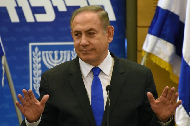 Israeli Prime Minister Benjamin Netanyahu gestures during a Likud Party meeting in the Knesset in Jerusalem on Tuesday. Netanyahu faced a second round of questioning by police over corruption allegations Friday, charged he said amount to nothing. Photo by Debbie Hill/UPI